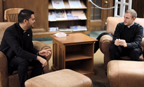 2 seminarians in the library.