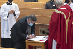 Signing the St. Mary's Covenant Book